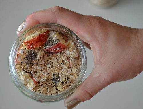 hand holding a jar of overnight oats