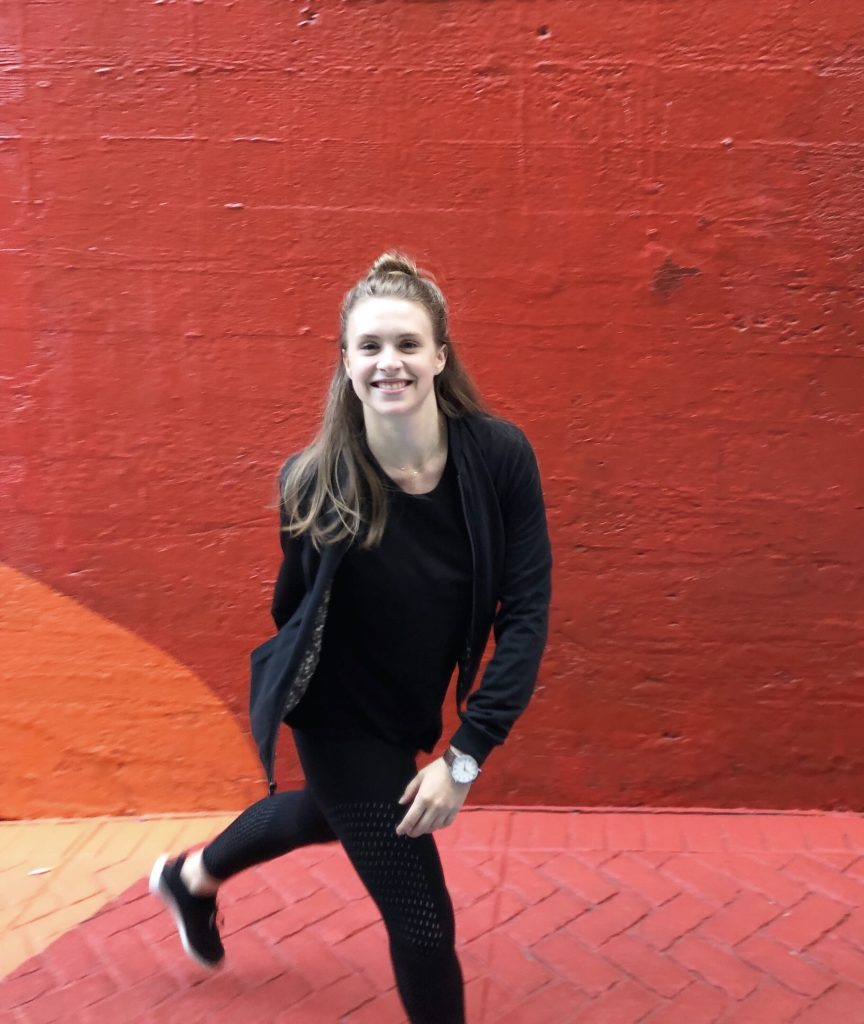 girl in red alley wearing all black